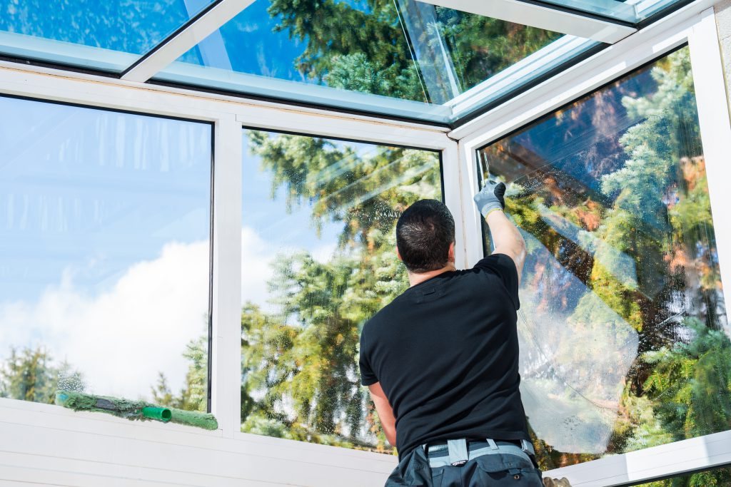 Conservatory window cleaning from interior.