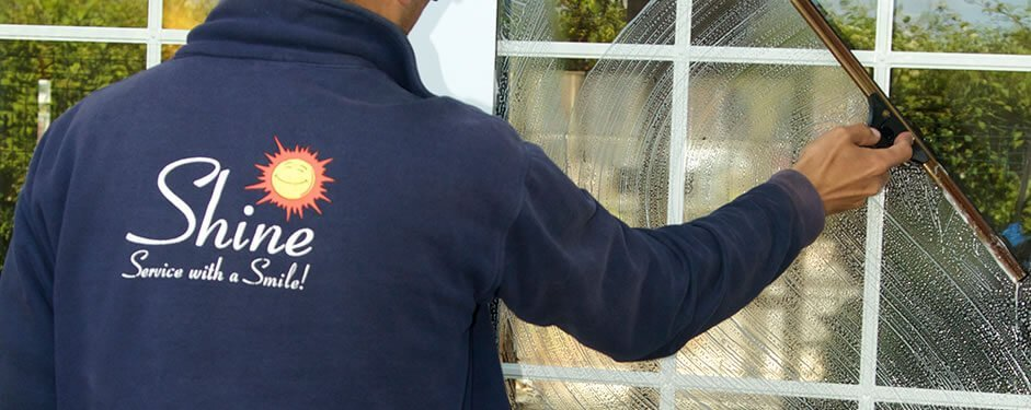 Window cleaning home windows by professional window washer at Shine