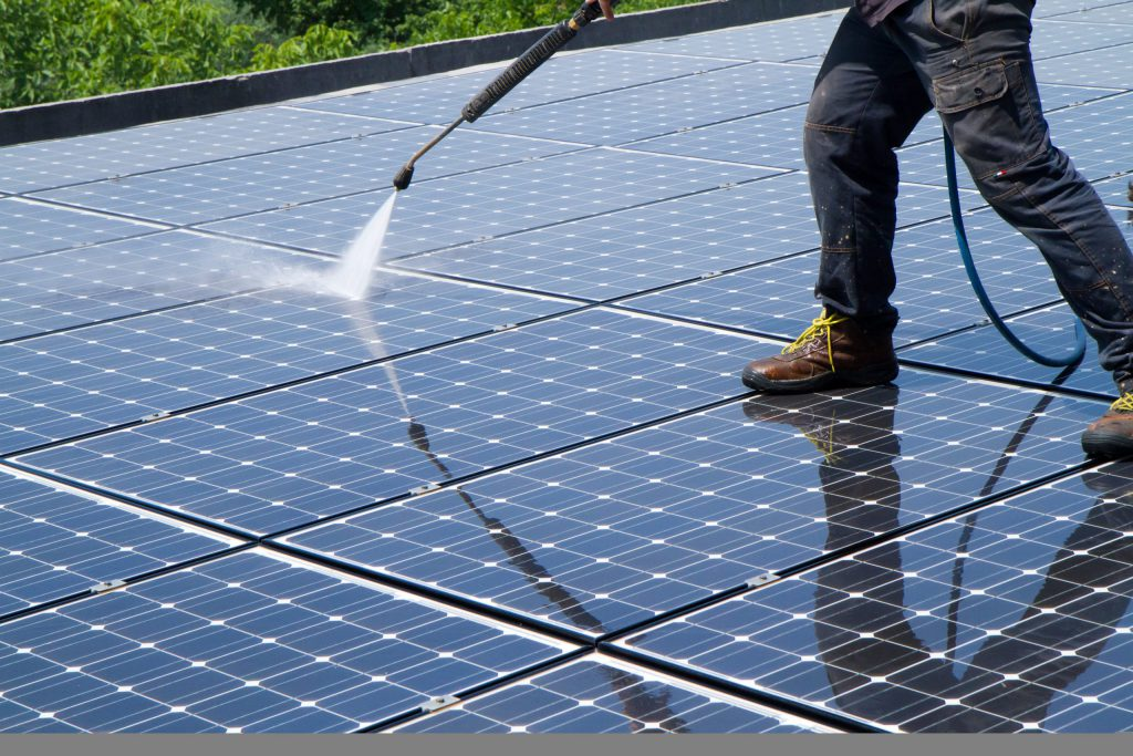 Washing and cleaning solar panel by Shine in Bristol.